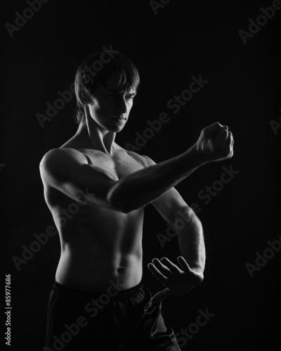 1ee6ad90830619 Fototapeta mężczyzna kick-boxing sztuka - Dekowizja.pl